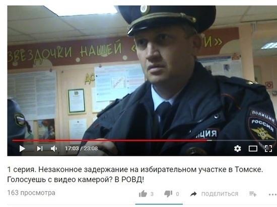 Томича забрали в отделение полиции за то, что он пришел на выборы с видеокамерой